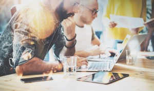 Startup Diversity Teamwork Brainstorming Meeting Concept.Business Team Coworkers Analyze Finance Report Laptop.People Working Start Up Process.Group Young Hipsters Discussing Office.Blurred Background